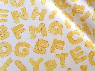 【オーガニックコットン サテン生地】biscuits alphabet(plain)98cm単位(幅142cm):受注生産の画像