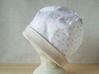 【値下げ】ニットのリバーシブル帽子*プチプチフラワーオレンジ×ベージュの画像