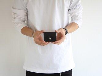 手元にすっぽり収まるかわいいコインケースの画像
