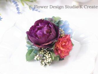 紫のラナンキュラスのコサージュ 結婚式 パーティー お出掛け フォーマル お洒落の画像