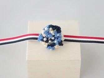 小花の帯留め(ブルー)の画像