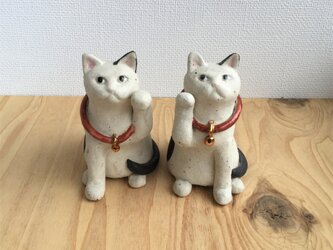 白黒ぶちのまねき猫の画像