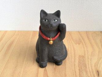 黒猫のまねき猫の画像