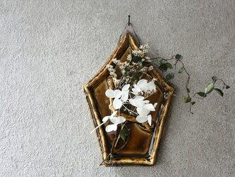 陶の壁掛け(5角・茶色)の画像