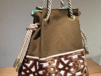 brown:帆布✖インテリアブレードの巾着バックの画像