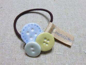 ボタンヘアゴム × イエローの画像