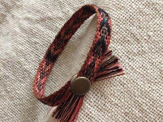 手織りのブレスレット オレンジ×黒 (A)の画像