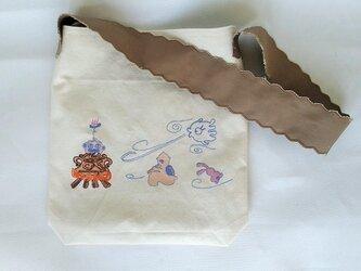 刺繍入り帆布ショルダーバッグ ハニィ&ドグゥ 火焔風呂の画像