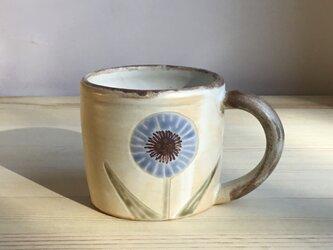 てんとう虫と花のコーヒーカップの画像