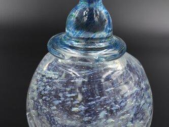 青い帽子の小瓶の画像