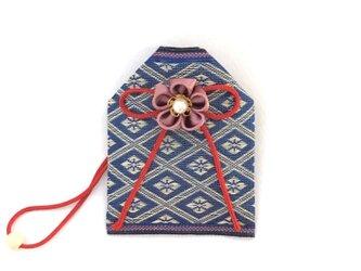 畳の「縁結び」お守り袋(菱形赤糸)の画像