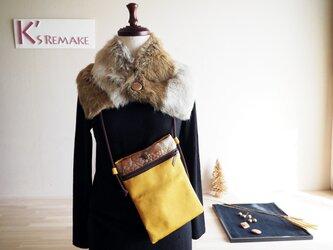 マスタード色の単衣帯と金茶のふくれ帯のサコッシュの画像