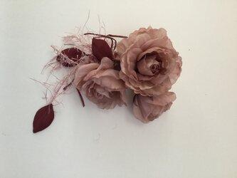 渋いピンク薔薇の飾り紐付きの画像