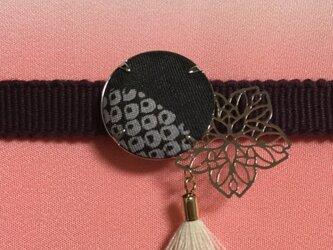 タッセル付き桜の帯留めの画像