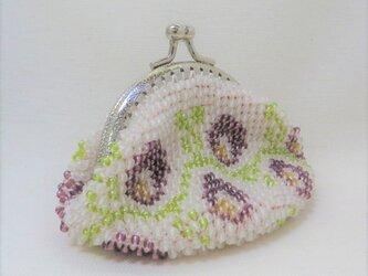 ビーズがま口(半透明に紫色の花)の画像