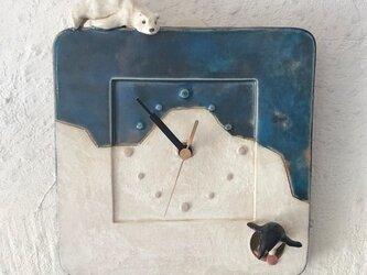 陶の壁掛け時計(小)「Arctic Antarctic」の画像