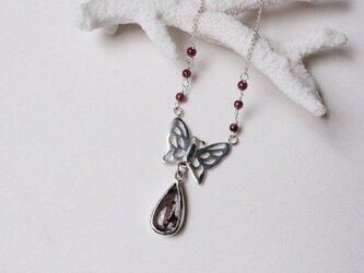蝶とスーパーセブンのネックレスの画像