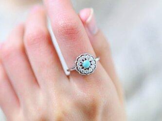 人生の守護石 スリーピングビューティー ターコイズのフラワー リング 指輪 12月誕生石 フリーサイズの画像