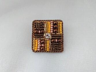 メタル調 yellow broochの画像