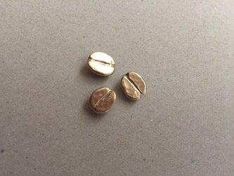 コーヒー豆のピンバッヂの画像