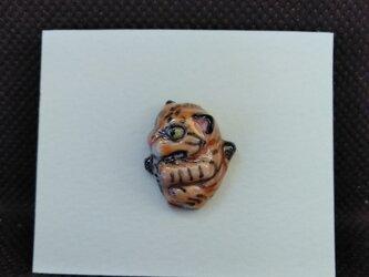 動物石 ピンズ ちょびら(橙色)の画像