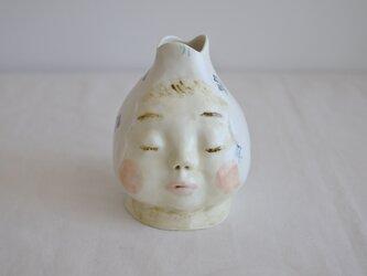 お包み赤ちゃん花器の画像