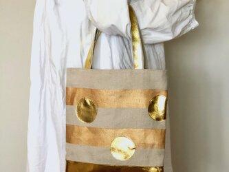 リネンキャンバスボーダー&ゴールドレザー水玉バッグの画像