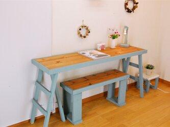 三脚足テーブル140*38(テーブルブルー) 組立型の画像
