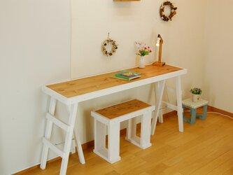 三脚足テーブル140*38(ホワイト) 組立型の画像