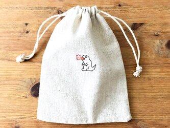 刺繍入り巾着袋 「火を吹くカイジュウ」の画像