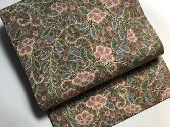 椿花唐草模様紬の名古屋帯の画像