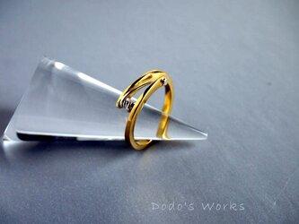 真鍮とシルバーの糸巻きリングの画像