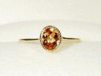 K10と0.90ctインペリアル・トパーズの指輪(リングサイズ:10号、サイズ変更可、天然石、ミル打ち、ふくりん)の画像