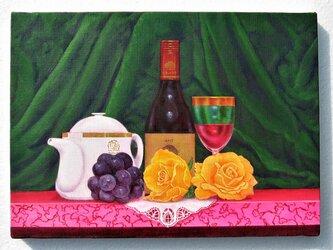 黄色い薔薇とワインの画像