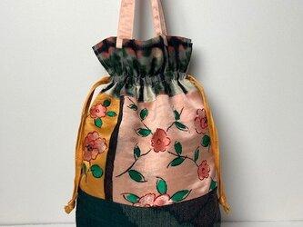 【着物・帯リメイク】巾着トートバッグ/オレンジに花帯地・紬・銘仙の画像