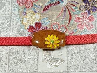 木製帯留め(福寿草)の画像