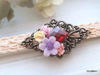 【現品限り】ジルコニアとお花の帯留めの画像