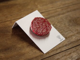 紙束のピアス 楕円 赤 1個の画像