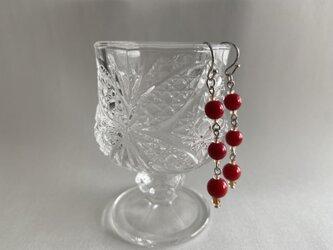 赤いベネチアンガラスのピアスの画像