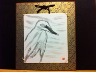川辺を歩く白鷺の画像