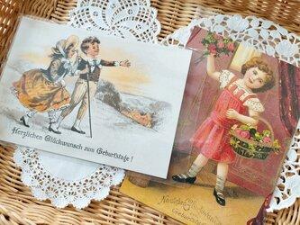 ドイツ製ポストカード【Germay】2枚セット(花かごをもった少女/夜明けの丘)の画像