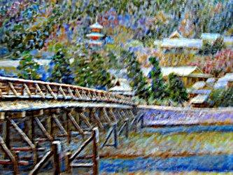 初冠雪の渡月橋の画像