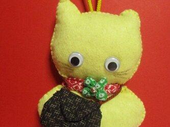 幸せの黄色い猫のチャームの画像