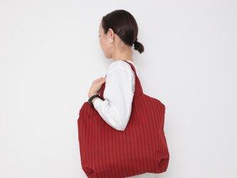 Hand block print kinchaku bag / aka shimaの画像