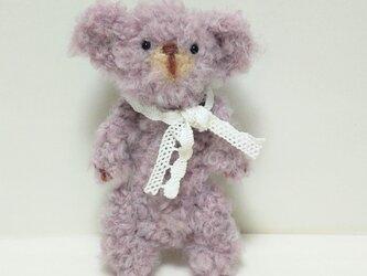 薄紫色のテディベア(編みぐるみ)の画像