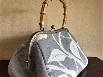 枝葉模様紬の名古屋帯の竹の手がま口手提げの画像
