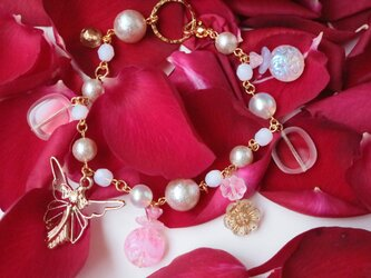 アールデコな妖精と香水瓶のバッグチャーム(ピンク&ゴールド)の画像