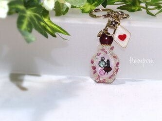 20c012_アリスの香水瓶キーホルダー ホムポムの画像