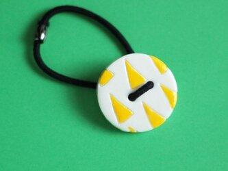 磁器ボタンゴム 丸サンカク イエローの画像