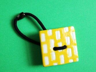 磁器ボタンゴム・四角 ミシン イエローの画像